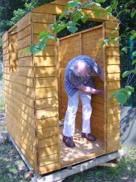 Novice allotment holder putting up a shed
